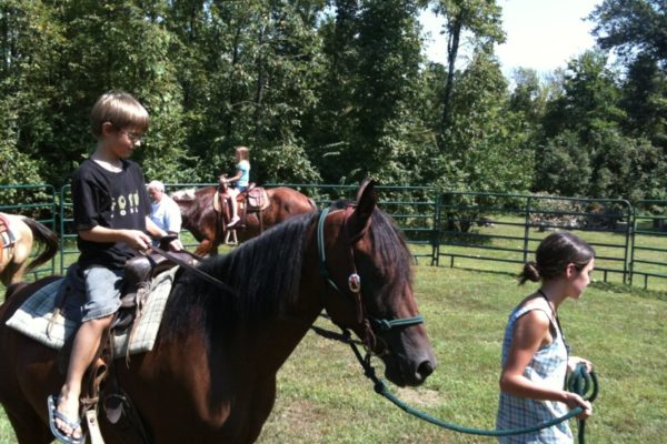 Lacy and horses giving rides